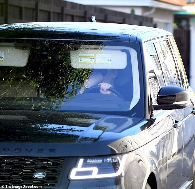 Adele is seen in Los Angeles at the exit of a workout in the gym