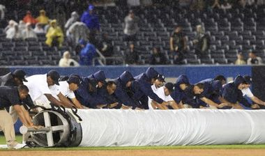 Yankee Stadium ground crew had difficulty rolling out the tarp.