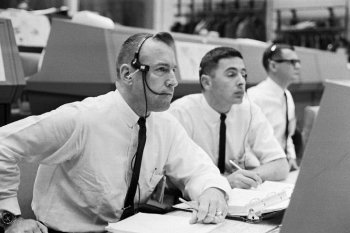Black and white image of NASA mission control personnel.