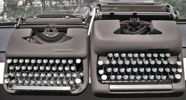 Photo of two typewriters.