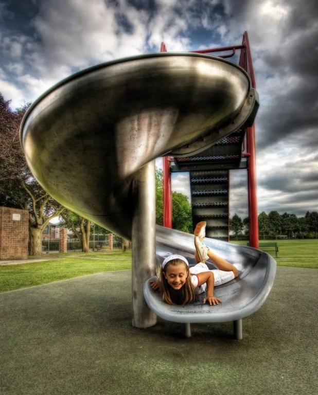 Photo of girl on a slide that is representative of Slideshare