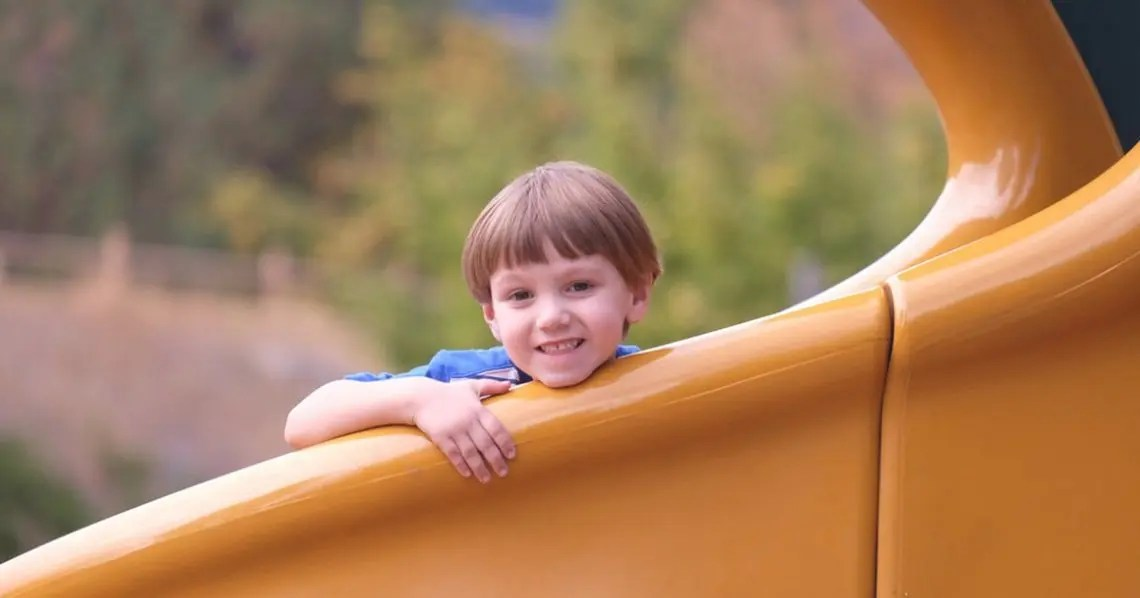 Photo of boy on slide representative of slideshare