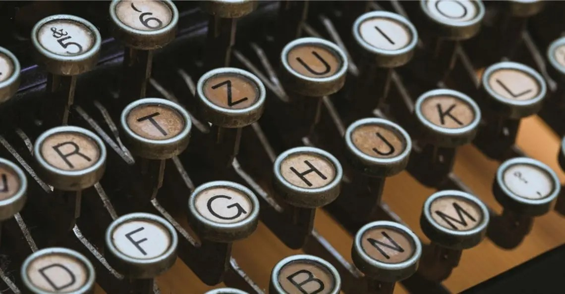 Photo of typewriter keys representative of blog posts