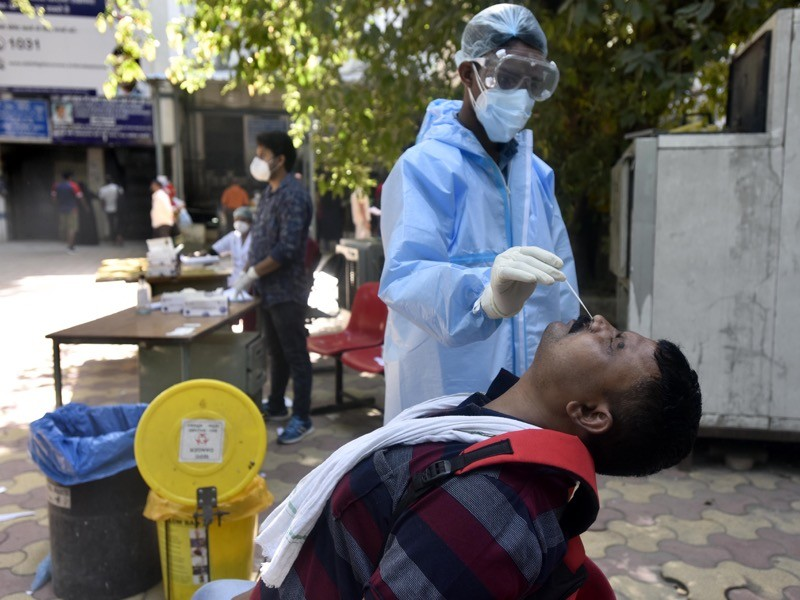 A health worker collected samples for coronavirus antigen testing, in New Delhi, India.