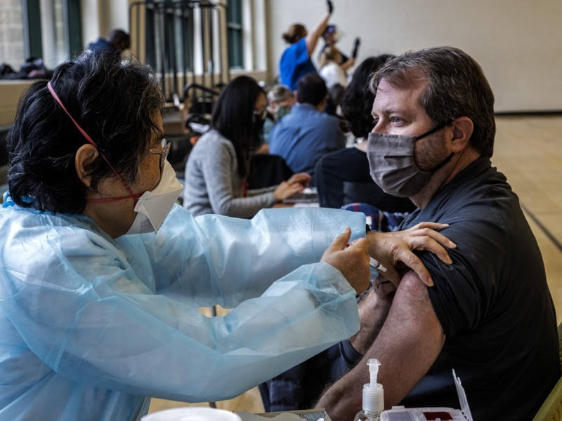 Mark Adamec, medical personal trainer, gets his Moderna shot.