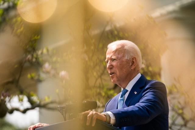 U.S. president Joe Biden makes a speech at a lectern in the Rose Garden of the White House garden