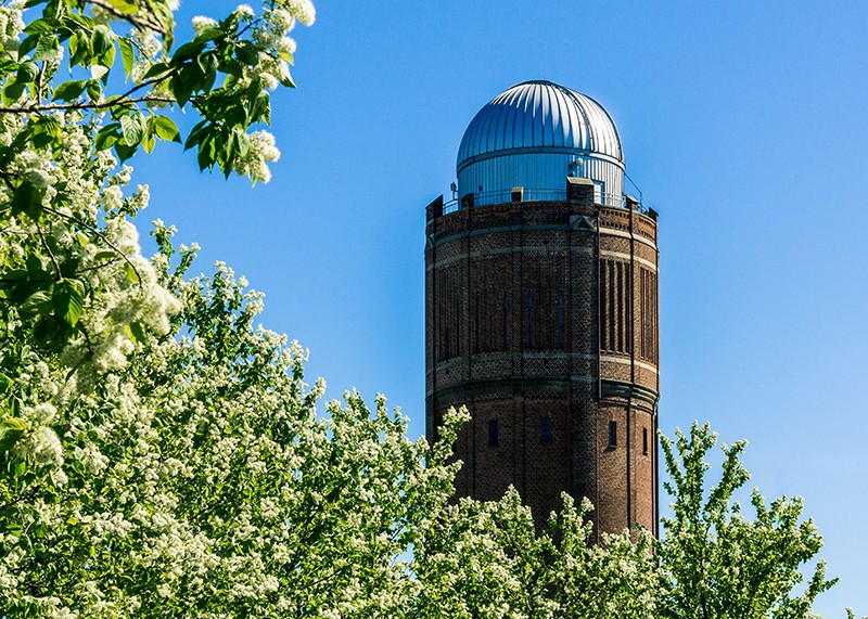 The old observatory with spring tree growth.