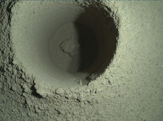 A composite image of the first borehole drilled by NASA's Perseverance rover on Mars
