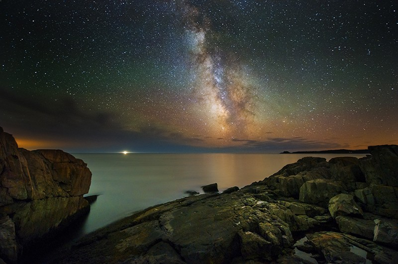 Starry sky over water in Maine