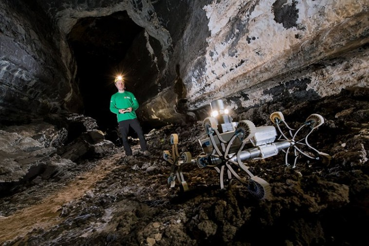 Astronaut and rover in lava tube