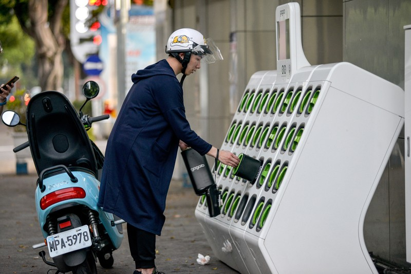 A motorcyclist uses a battery swapping station in Taiwan