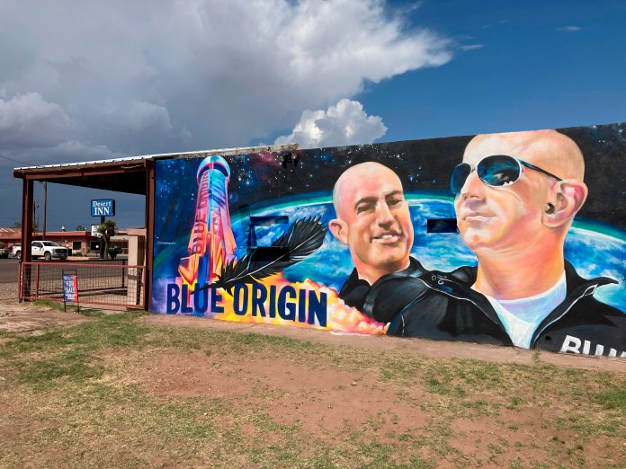 The side of a building in Van Horn, Texas, is adorned with a mural of Blue Origin founder Jeff Bezos on Saturday, July 17, 2021, just days before Bezos plans to launch into space from the Blue Origin spaceport about 25 miles outside of the West Texas town.