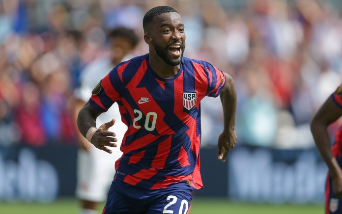 Shaq Moore #20 of the United States scores and celebrates his goal during a game between Canada and USMNT at Children's Mercy Park on July 18, 2021 in Kansas City, Kansas