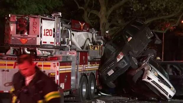 [NY] FDNY Truck Slams Into Row of Parked Cars on NYC Street