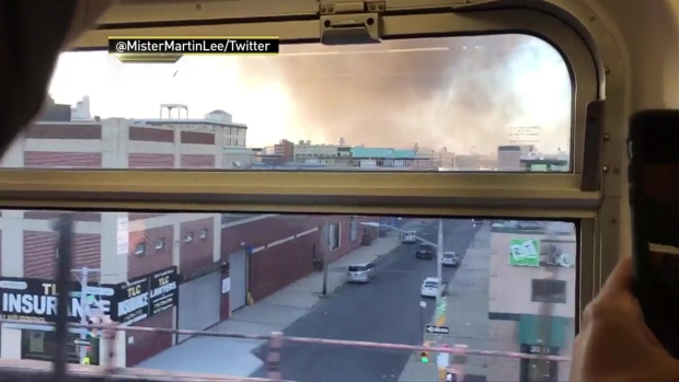 Raging Queens Fire Sends Black Smoke into Sky