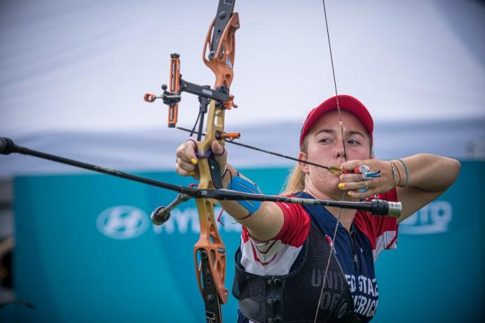 Casey Kaufhold aims bow and arrow