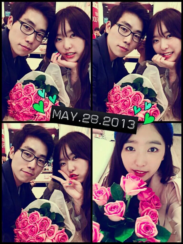A couple posing for a selfie with hot pink flowers