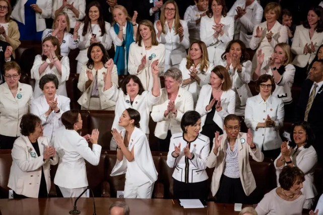 """Image result for women, he was greeted by cheers and chants of """"USA, USA"""" from Democrat congresswomen dressed in white in tribute to the suffragettes."""