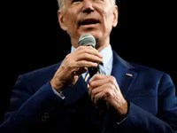 Joe Biden speaking into a microphone.