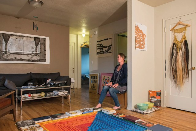 Image may contain Flooring Human Person Living Room Indoors Room Wood Furniture Couch Hardwood Plywood and Floor