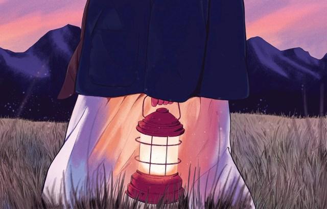 Waistdown view of someone carrying a lantern