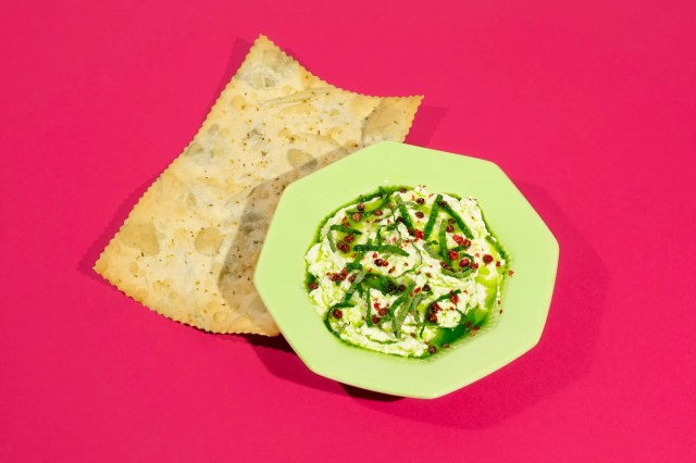 Harvest Moons ricottaandpea dip topped with pink peppercorns and served with an herbflecked cracker.