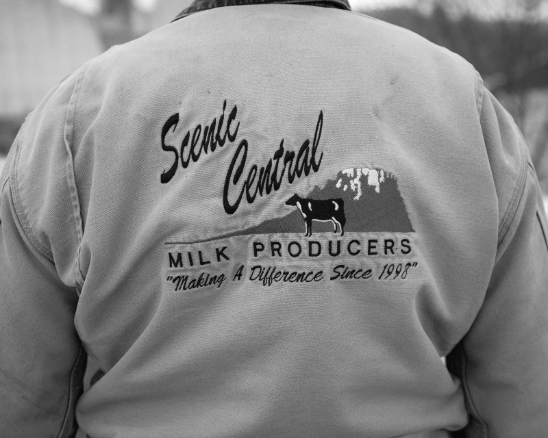 A jacket advertising Scenic Central Milk Producers.