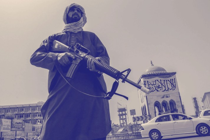 A Taliban fighter stands guard at a checkpoint in Kandahar Afghanistan on August 17 2021.