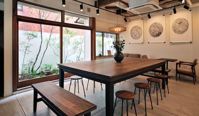 A large co-working table at Kaisu Hostel in Tokyo, Japan