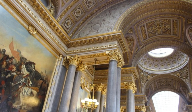 the lavish interior of the historic Palace of Versailles in France
