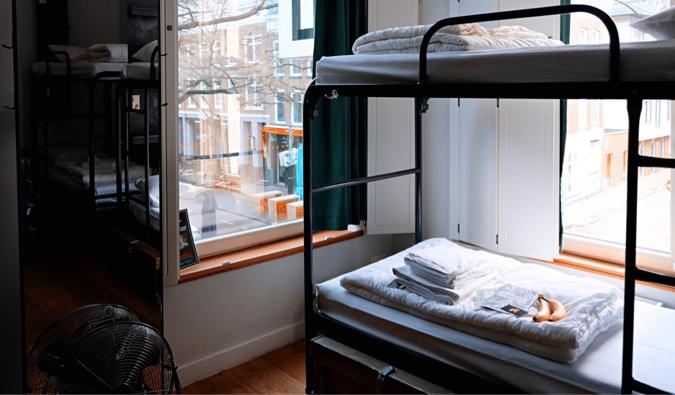 Cozy bunk beds in a hostel dorm room in Europe