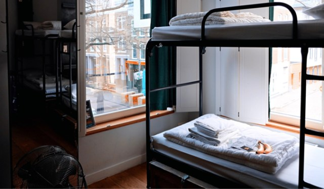 Cozy bunk beds in a hostel dorm room in Europe