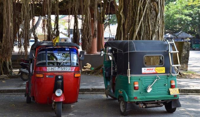 Old tuk-tuks parked together in Sri Lanka
