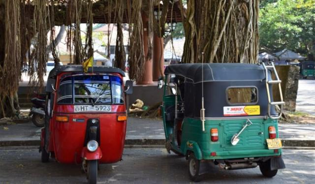 Old tuk-tuks parked together in Sri Lanka