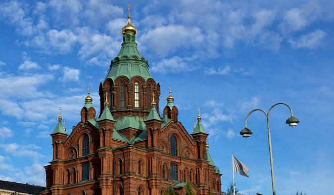 The towering Uspenski Church on a summer day in Helsinki, Finland