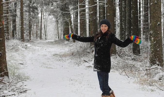 Kristin Addis playing in the snow overseas