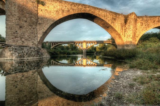 Photo of old bridges in the Medieval town of Besalú, Spain