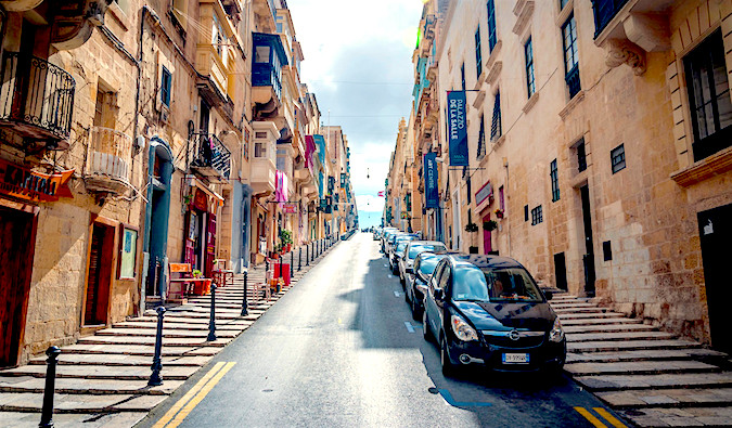 cars on a colorful street in malta, photo by Tobias Scheck (flickr: @uncloned)