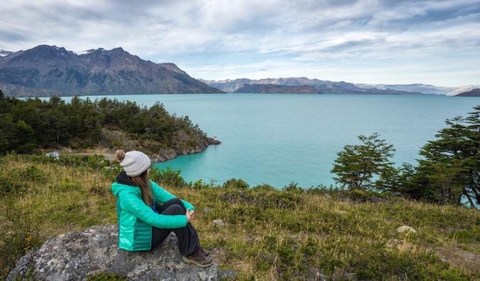 Woman sitting on a glacier