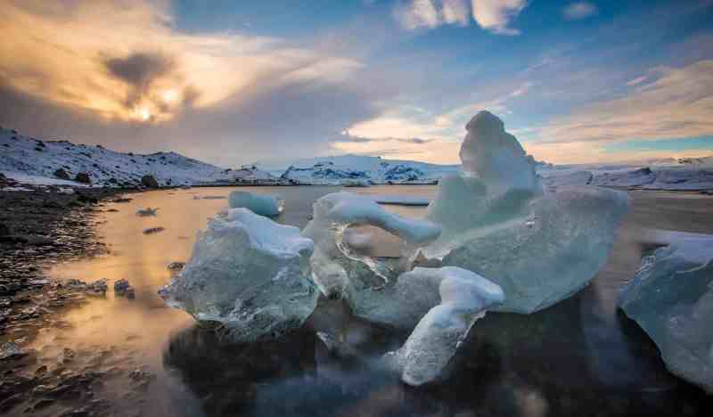 photographing ice in the lagoon in Iceland