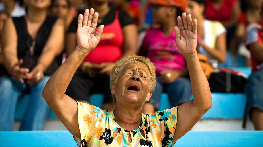 A Cuban evangelical attends an open-air service in Havana in 2009
