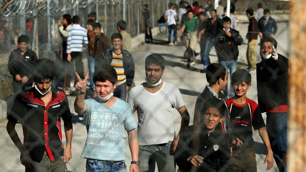 Immigrants wait at a detention center in the village of Fylakio near the  the Greek-Turkish border.