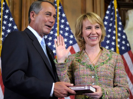 Rep. Gabrielle Giffords, D-Ariz., poses with House Speaker John Boehner Wednesday on Capitol Hill in Washington.