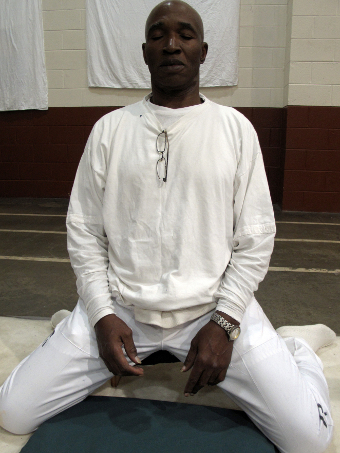 "Convicted murder Johnny Mack Young in the meditation stance he keeps for nearly 10 hours a day during the 10-day silent meditation course. Officials say the meditation program is reducing violence at Alabama's highest security lockup. ""It changed my life,"" Young says."