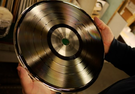 EKS owner Will Socolov holds a stamper — half of a pair of nickel plated discs with a spiral ridge to press a groove into one side of soft vinyl.