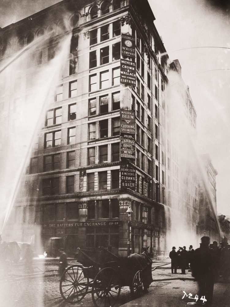 In Flames: Firefighters spray water on the upper floors of the Asch Building, which housed the Triangle Shirtwaist Company. Many workers died after jumping from the 10-story building.