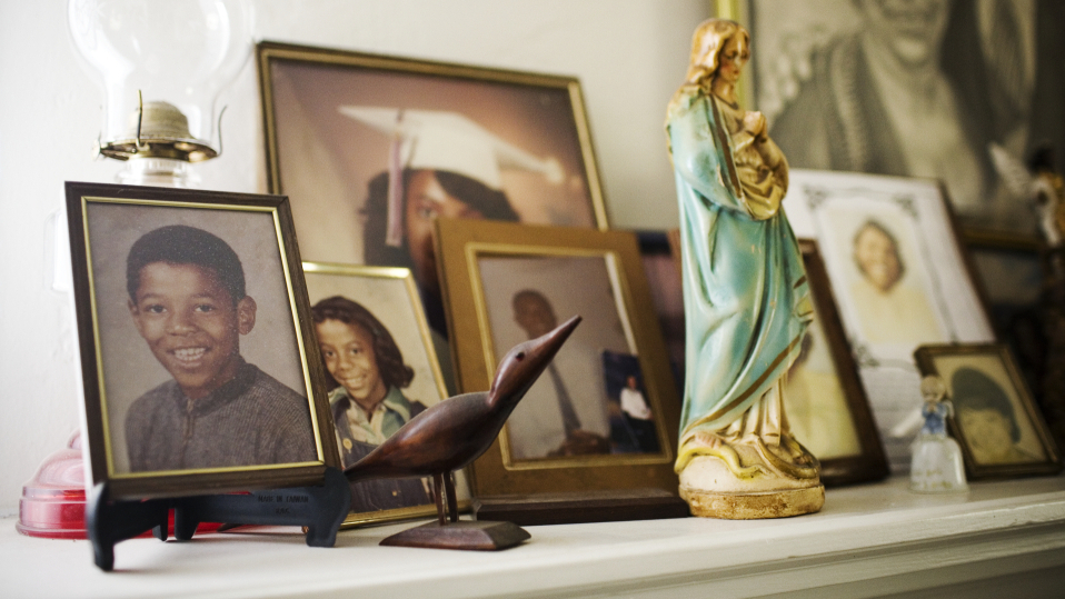 At left, a school portrait of Robert Dixon Jr., on the mantle of his father's home in Stockton, Calif. Though friends and family swear he is a reformed man, Dixon is unlikely to win parole because a test has determined he is a psychopath.