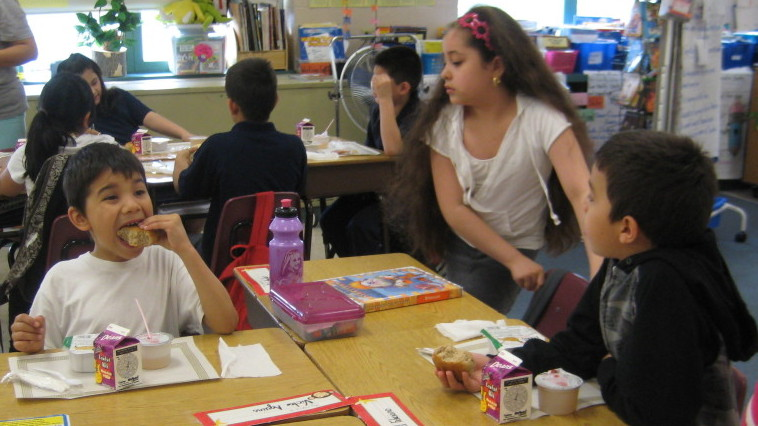Students eat breakfast in the classroom at McAuliffe  Elementary on Chicago's Northwest Side. The school implemented the Breakfast in the Classroom program voluntarily three  years ago.