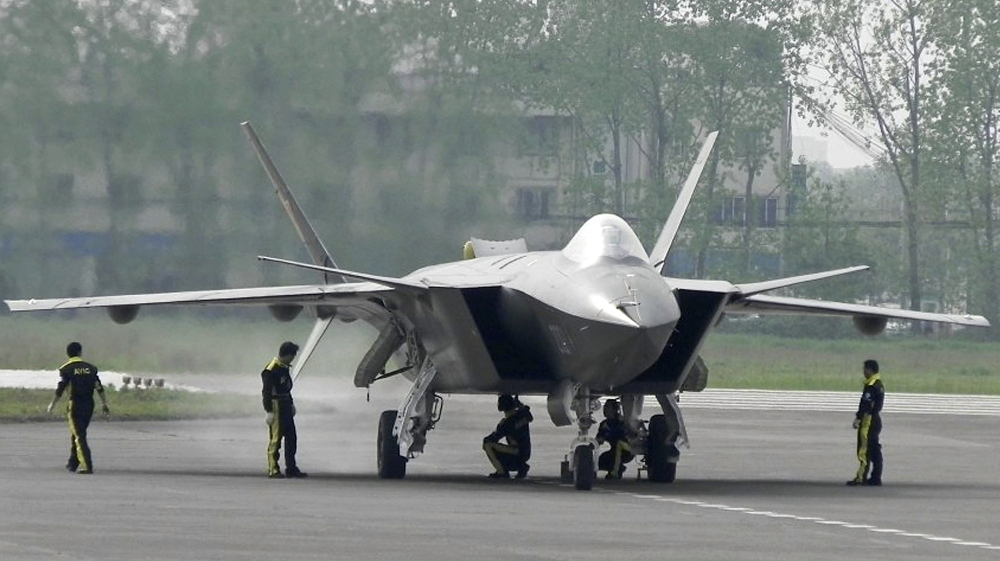 A J-20 stealth fighter is inspected by Chinese air force ground crew members in Chengdu on April 17. China performed the first test flight of the J-20 during a visit by U.S. Defense Secretary Robert Gates in January.