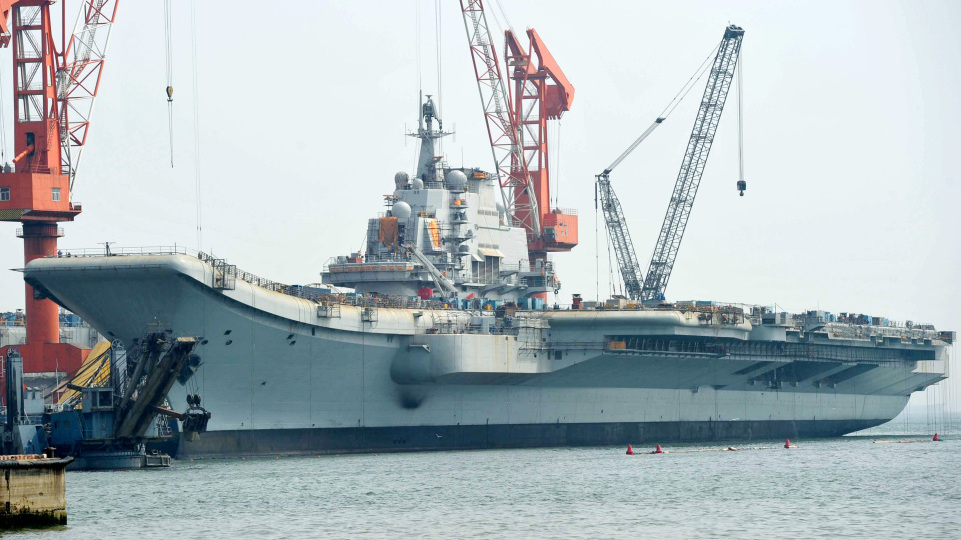 """The Varyag aircraft carrier, shown April 26, is being renovated at a shipyard in the northern Chinese city of Dalian. After years of refurbishing work, the carrier — bought from Ukraine — has been described as """"on the verge of setting out"""" by Xinhua state news agency."""